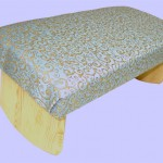 padded-meditation bench with blue fabric and gold detail